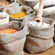 Corn and grains in bags — Stock Photo #57832833