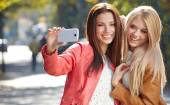Beautiful young women making selfie — Stock Photo