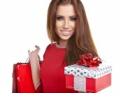 Woman with Christmas gift and shopping bags — Stock Photo