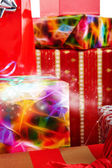 Christmas gifts in colorful wrapping with ribbons — Stock Photo