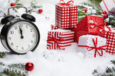 Alarm clock with snow and Christmas decorations — Stock Photo