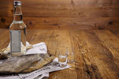 Dried fish on old newspaper — Stock Photo