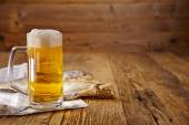 Beer and dried fish on wooden table — Stock Photo
