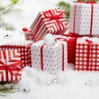 Small Handmade gift boxes in snow — Stock Photo #59580275