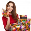 Cheerful santa helper girl with gift box — Stock Photo #59580347