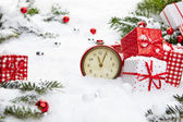 Alarm clock and Christmas decorations — Photo