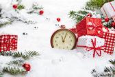 Alarm clock and Christmas decorations — Stock Photo