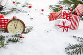 Alarm clock and Christmas decorations — Stockfoto