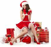 Girl wearing santa claus clothes with gift — Stock Photo
