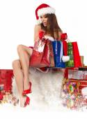 Girl wearing santa claus clothes with gifts — Fotografia Stock