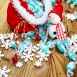 Decoration snowman with candy in sack — Stock Photo #60507747