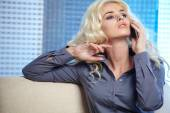 Woman talking on mobile phone at home — Stock Photo
