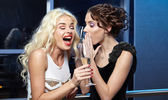 Women with a champagne glasses at celebration — Stockfoto
