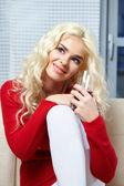 Woman posing on sofa — Stock Photo