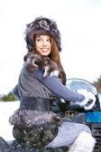 Woman riding a snowmobile — Stock Photo