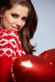 Woman holding red balloon — Stok fotoğraf