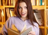 Student in a university library — Stock Photo