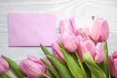 Tulips and post card — Stock Photo