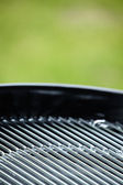 New barbecue grill in summer garden, outside, nobody — Stock Photo
