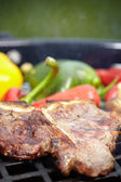 T-bone steak with vegetable spears — Stock Photo