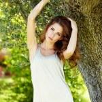 Beautiful woman under an olive tree — Stock Photo #64492979