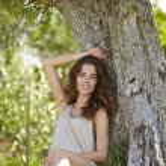 Beautiful woman under an olive tree — Stock Photo #64493001