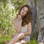 Beautiful woman under an olive tree — Stock Photo #64493017