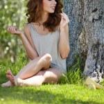 Beautiful woman under an olive tree — Stock Photo #64493043