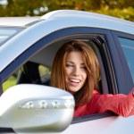 Happy woman with car key — Stock Photo #65708069