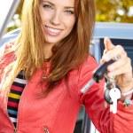 Happy woman with car key — Stock Photo #65708167