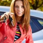 Happy woman with car key — Stock Photo #65708255