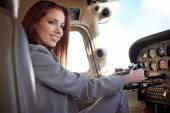 Female pilot preparing for a flight — ストック写真
