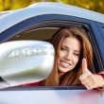 Happy woman with car key — Stock Photo #65755865
