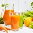 Carrot juice with fruits and vegetables — Stock Photo #67128441