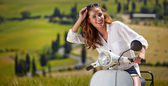 Woman sitting on a italian scooter — Stock Photo