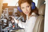 Beautiful Woman in cockpit — Stock Photo