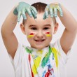 Boy with hands painted in colorful paints — Stock Photo #69084569