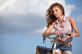 Sexy woman with vinntage bike — Stock Photo