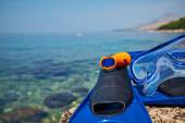 Mask and flippers on the beach — Stock Photo