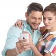 Happy hipster couple taking a selfie — Stock Photo #72025499