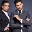Couple of managers in suits — Stock Photo #72805037