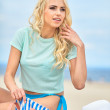 Young sexy model at beach — Stock Photo #77040335