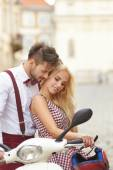 Love couple with retro scooter — Stock Photo