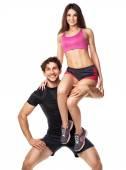 Tipo do desporto detém no ombro de uma garota em um fundo branco — Fotografia Stock