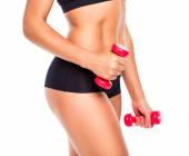 Beautiful slim woman with dumbbells, isolated on white — Foto Stock