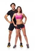 Athletic couple - man and woman after fitness exercise on white — Stock Photo
