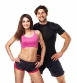 Athletic couple - man and woman after fitness exercise on white — Stockfoto