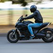 Young man riding a sport motorcycle on the road — Stock Photo #53453089