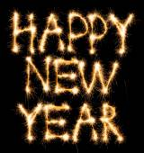 Happy New Year made of sparkles on black — Stock Photo