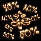 Sparkling inscription of 50 percent, 40 percent,30 percent, 20 percent with christmas tree o — Stock Photo